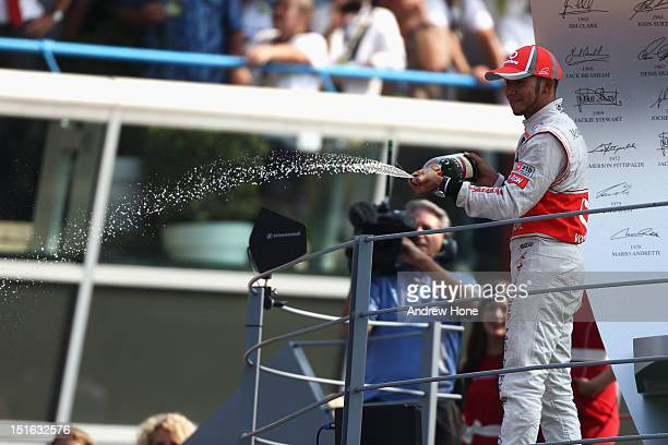 Lewis Hamilton of Great Britain and McLaren celebrates on the podium after winning the Italian Formula One Grand Prix at the Autodromo Nazionale di...
