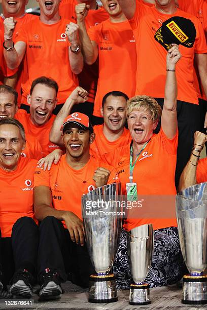Lewis Hamilton of Great Britain and McLaren celebrates with his mother Carmen Lockhart and team mates after winning the Abu Dhabi Formula One Grand...