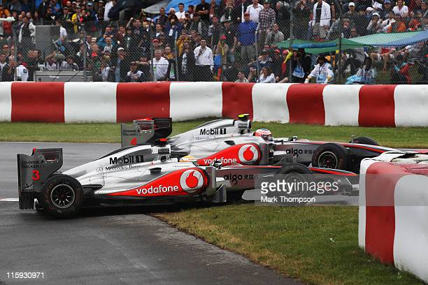 Lewis Hamilton of Great Britain and McLaren drives close to team mate Jenson Button of Great Britain and McLaren as he goes straight on at the first...