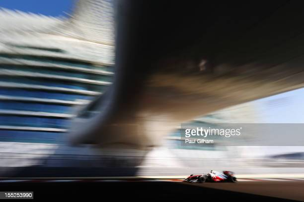 Lewis Hamilton of Great Britain and McLaren drives during practice for the Abu Dhabi Formula One Grand Prix at the Yas Marina Circuit on November 2,...