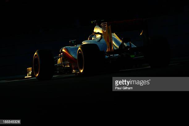 Lewis Hamilton of Great Britain and McLaren drives on his way to finishing first during qualifying for the Abu Dhabi Formula One Grand Prix at the...
