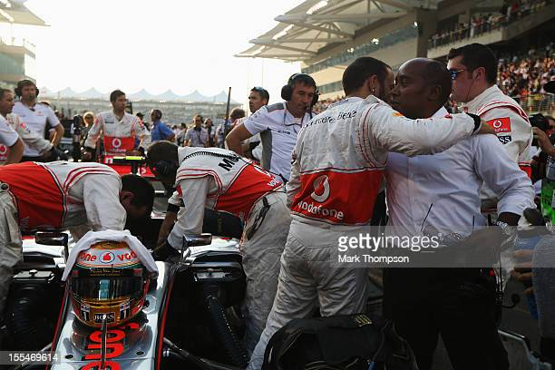 Lewis Hamilton of Great Britain and McLaren embraces his father Anthony Hamilton before the Abu Dhabi Formula One Grand Prix at the Yas Marina...