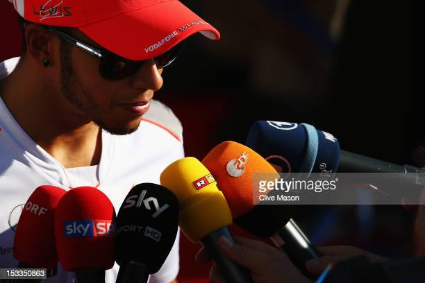 Lewis Hamilton of Great Britain and McLaren is interviewed by the media during previews for the Japanese Formula One Grand Prix at the Suzuka Circuit...