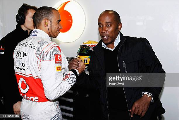 Lewis Hamilton of Great Britain and McLaren is seen with his father Anthony Hamilton before the Australian Formula One Grand Prix at the Albert Park...