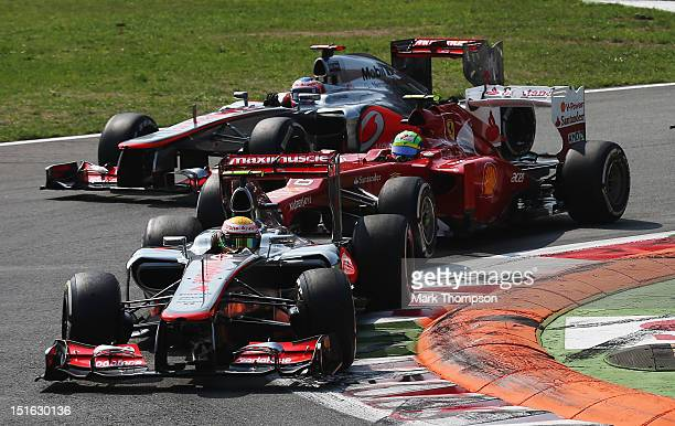 Lewis Hamilton of Great Britain and McLaren leads from Felipe Massa of Brazil and Ferrari and Jenson Button of Great Britain and McLaren at the start...