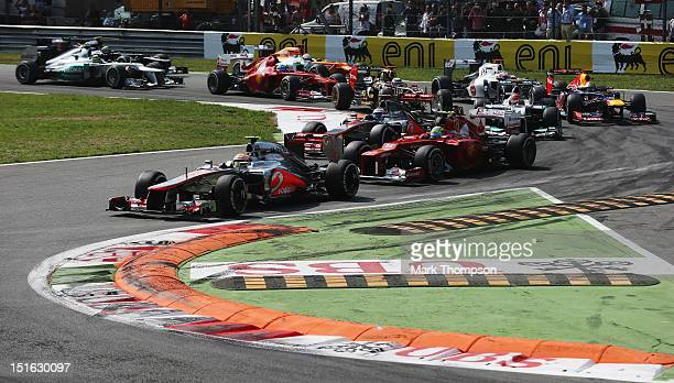 Lewis Hamilton of Great Britain and McLaren leads the field into the first corner at the start of the Italian Formula One Grand Prix at the Autodromo...