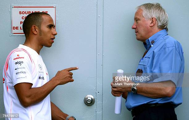 Lewis Hamilton of Great Britain and McLaren Mercedes and Charlie Whiting FIA Formula One Race Director talk before qualifying for the Canadian...