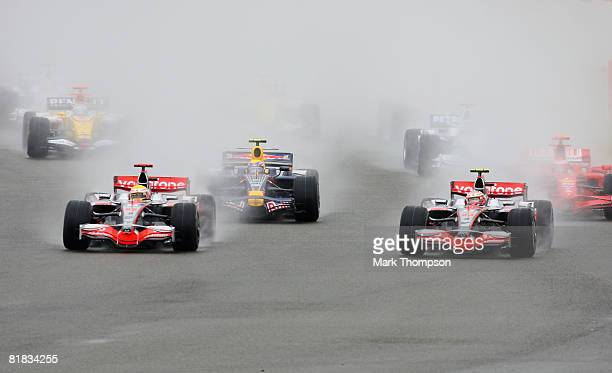 Lewis Hamilton of Great Britain and McLaren Mercedes and Heikki Kovalainen of Finland and McLaren Mercedes lead the field into the first corner at...