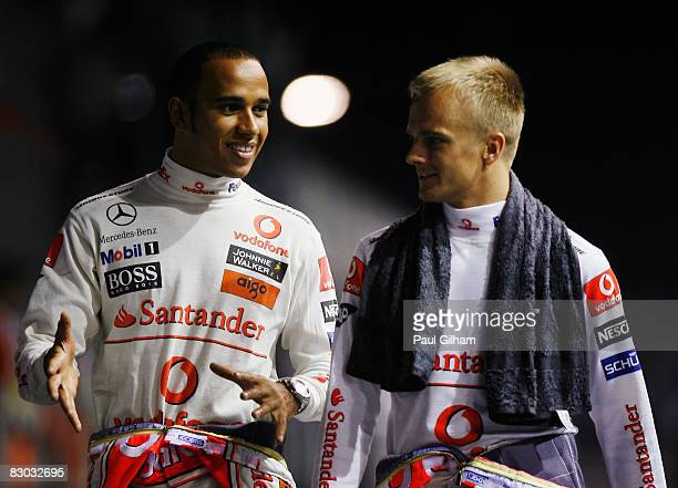 Lewis Hamilton of Great Britain and McLaren Mercedes and Heikki Kovalainen of Finland and McLaren Mercedes are seen following qualifying for the...
