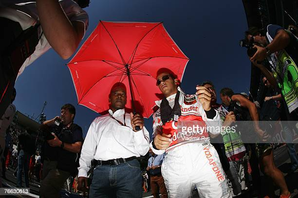 Lewis Hamilton of Great Britain and McLaren Mercedes and his father Anthony Hamilton on the grid before the start of the Italian Formula One Grand...