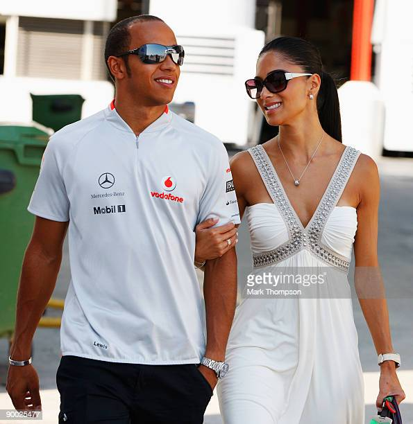 Lewis Hamilton of Great Britain and McLaren Mercedes and his girlfriend Nicole Scherzinger of the Pussycat Dolls walk in the paddock before the...