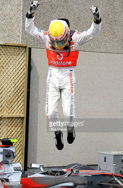 Lewis Hamilton of Great Britain and McLaren Mercedes celebrates winning his first Grand Prix in which he is the youngest to win the Canadian Formula...