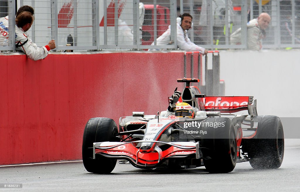 Lewis Hamilton of Great Britain and McLaren Mercedes celebrates in front of team mates as he crosses the finish line to win the British Formula One Grand Prix at Silverstone on July 6, 2008 in Northampton, England.