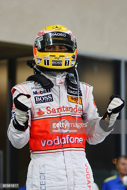 Lewis Hamilton of Great Britain and McLaren Mercedes celebrates in parc ferme after taking pole position during qualifying for the Abu Dhabi Formula...
