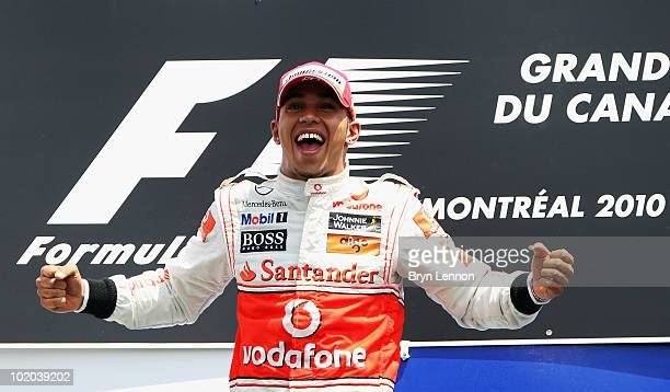Lewis Hamilton of Great Britain and McLaren Mercedes celebrates on the podium after winning the Canadian Formula One Grand Prix at the Circuit Gilles...