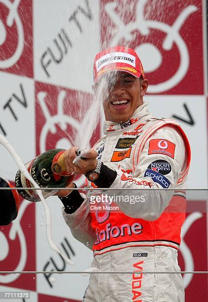 Lewis Hamilton of Great Britain and McLaren Mercedes celebrates on the podium after winning the Japanese Formula One Grand Prix at the Fuji Speedway...
