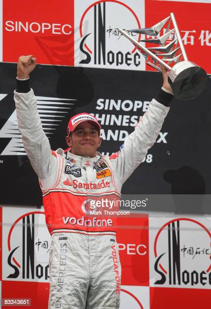 Lewis Hamilton of Great Britain and McLaren Mercedes celebrates on the podium after winning the Chinese Formula One Grand Prix at the Shanghai...