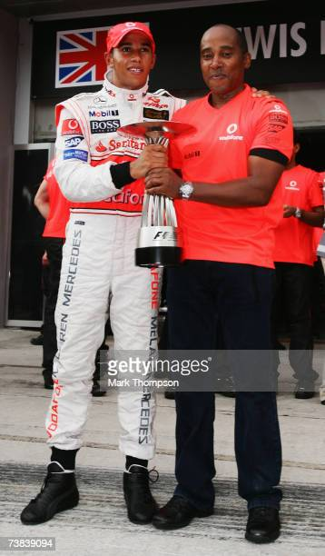 Lewis Hamilton of Great Britain and McLaren Mercedes celebrates with his father Anthony Hamilton following his second place in the Malaysian Formula...