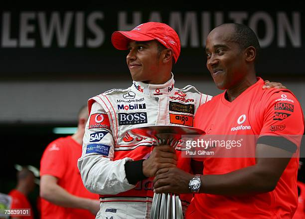 Lewis Hamilton of Great Britain and McLaren Mercedes celebrates with his father Anthony Hamilton following his second place finish in the Malaysian...