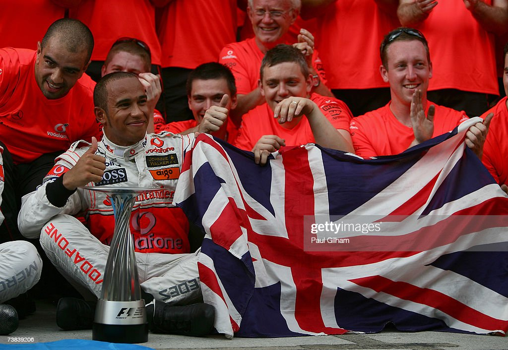 Lewis Hamilton of Great Britain and McLaren Mercedes celebrates with team-mates after finishing second in the Malaysian Formula One Grand Prix at the Sepang Circuit on April 8, 2007, in Kuala Lumpur, Malaysia.