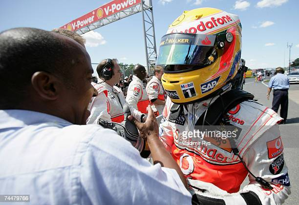 Lewis Hamilton of Great Britain and McLaren Mercedes celebrates with his father Anthony after winnning the qualifying for the Canadian Formula One...