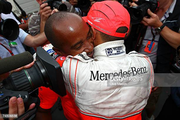 Lewis Hamilton of Great Britain and McLaren Mercedes celebrates with his father Anthony Hamilton in the paddock after winning his first Grand Prix in...