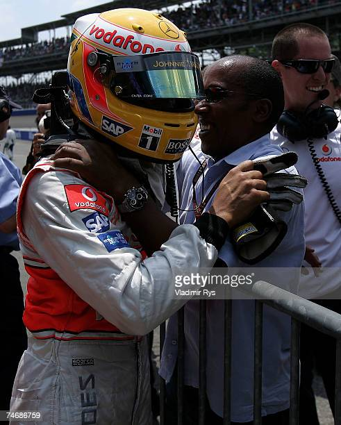 Lewis Hamilton of Great Britain and McLaren Mercedes celebrates with his father Anthony after finishing first during qualifying for the F1 Grand Prix...