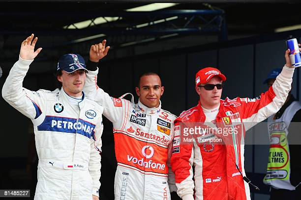 Lewis Hamilton of Great Britain and McLaren Mercedes celebrates with second placed Robert Kubica of Poland and BMW Sauber and third placed Kimi...