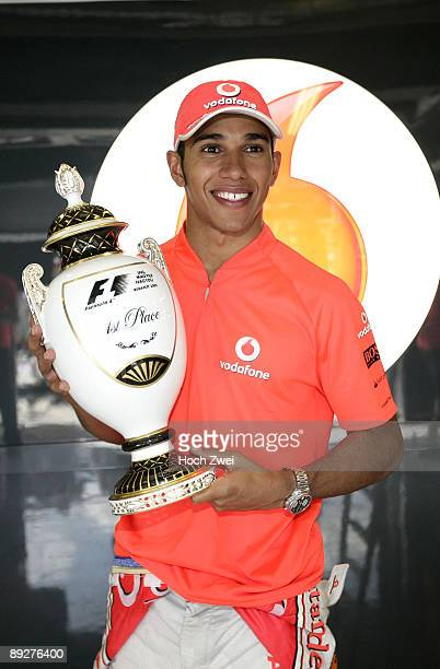 Lewis Hamilton of Great Britain and McLaren Mercedes celebrates with his trophy after winning the Hungarian Formula One Grand Prix at the Hungaroring...