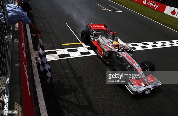 Lewis Hamilton of Great Britain and McLaren Mercedes crosses the finish line to win the British Formula One Grand Prix at Silverstone on July 6, 2008...