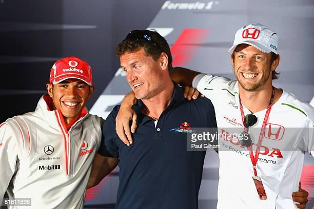 Lewis Hamilton of Great Britain and McLaren Mercedes, David Coulthard of Great Britain and Red Bull Racing and Jenson Button of Great Britain and...