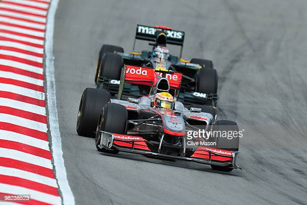 Lewis Hamilton of Great Britain and McLaren Mercedes drives during the Malaysian Formula One Grand Prix at the Sepang Circuit on April 4, 2010 in...