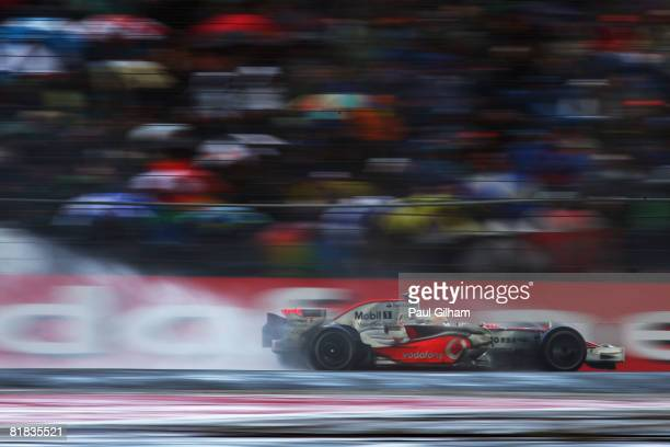 Lewis Hamilton of Great Britain and McLaren Mercedes drives on his way to victory during the British Formula One Grand Prix at Silverstone on July 6,...