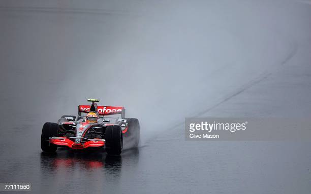 Lewis Hamilton of Great Britain and McLaren Mercedes drives through the wet conditions on his way to winning the Japanese Formula One Grand Prix at...