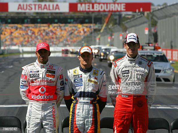Lewis Hamilton of Great Britain and McLaren Mercedes, Heikki Kovalainen of Finland and Renault and Adrian Sutil of Germany and Spyker F1 pose before...