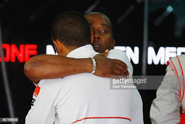 Lewis Hamilton of Great Britain and McLaren Mercedes is embarced by his father Anthony Hamilton in his team garage before qualifying for the...