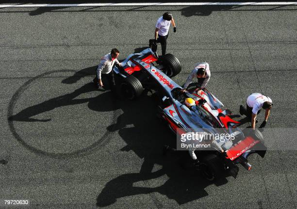 Lewis Hamilton of Great Britain and McLaren Mercedes is pushed back into the pits during Formua One Testing at the Circuito de Jerez on February 12...