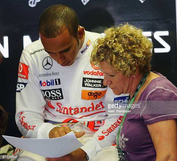 Lewis Hamilton of Great Britain and McLaren Mercedes is seen in his team garage with his mother Carmen Lockhart during practice for the Canadian...