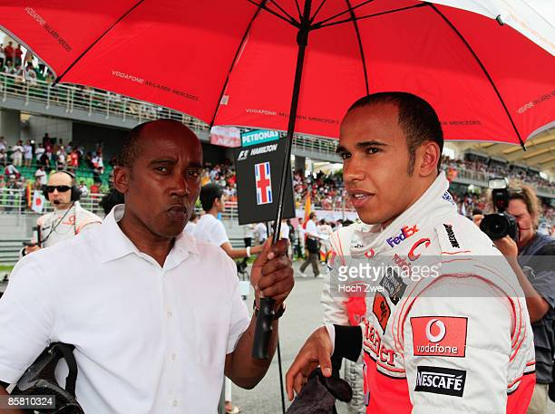 Lewis Hamilton of Great Britain and McLaren Mercedes is seen with his father Anthony Hamilton on the grid before the start of the Malaysian Formula...