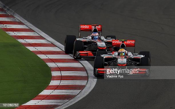 Lewis Hamilton of Great Britain and McLaren Mercedes leads from team mate Jenson Button of Great Britain and McLaren Mercedes on his way to winning...