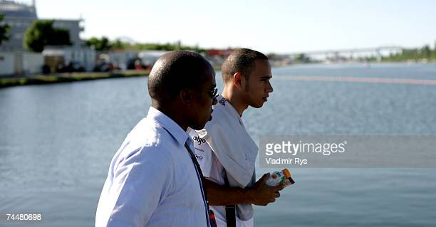 Lewis Hamilton of Great Britain and McLaren Mercedes leaves the paddock accompanied by his father Anthony after qualifying for the Canadian Formula...
