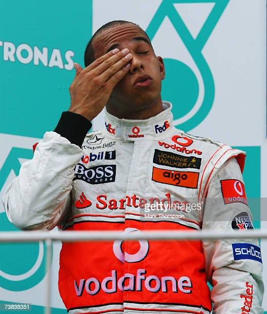 Lewis Hamilton of Great Britain and McLaren Mercedes looks exhausted on the podium following his second place in the Malaysian Formula One Grand Prix...