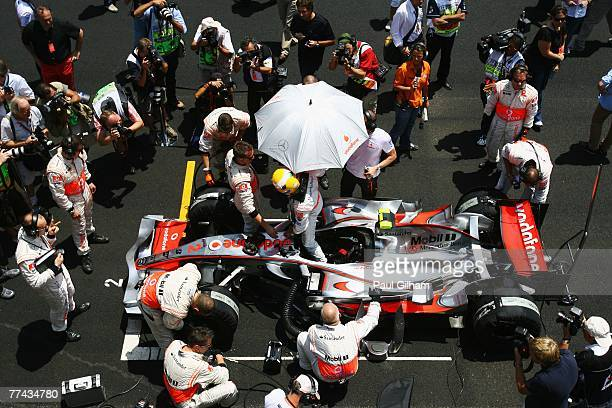 Lewis Hamilton of Great Britain and McLaren Mercedes prepares on the grid before driving in the Brazilian Formula One Grand Prix at the Autodromo...