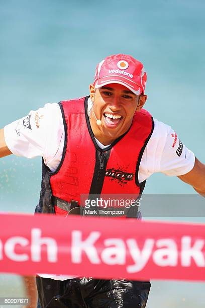 Lewis Hamilton of Great Britain and McLaren Mercedes runs to the finish tape while taking part in a beach kayak race at Williamstown Beach during...