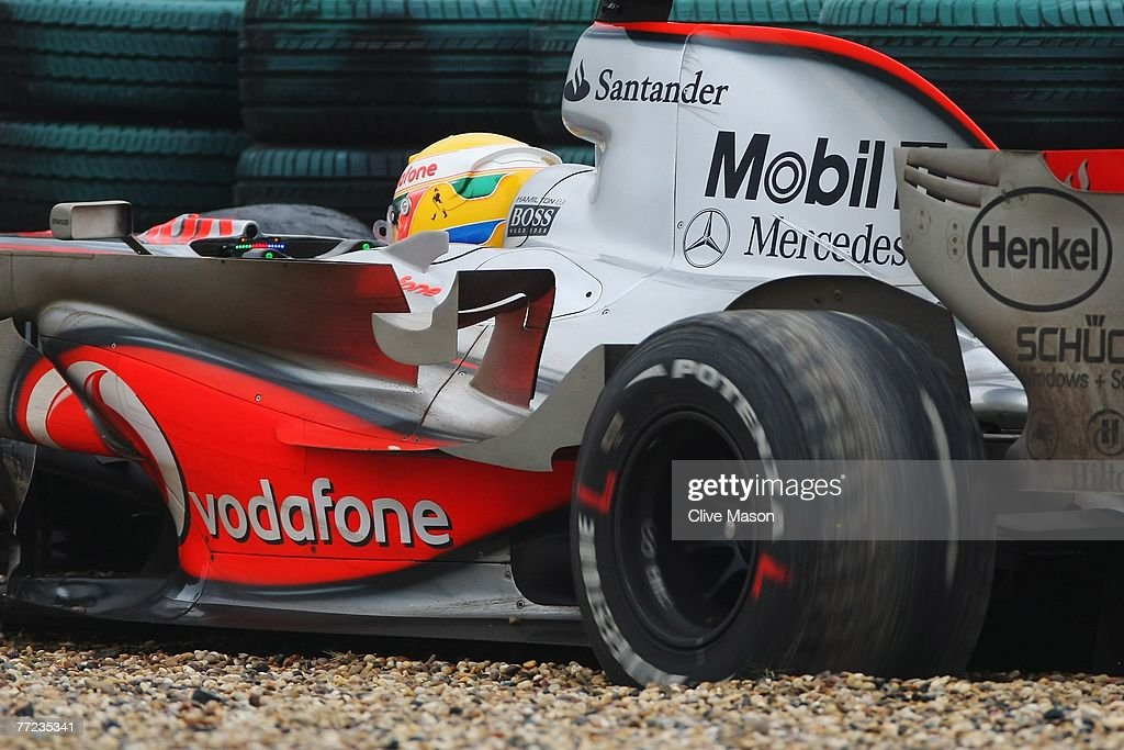 Lewis Hamilton of Great Britain and McLaren Mercedes spins his rear tyres in the gravel as he retires early from the Chinese Formula One Grand Prix at the Shanghai International Circuit on October 7, 2007 in Shanghai, China.