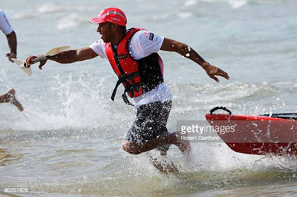 Lewis Hamilton of Great Britain and McLaren Mercedes takes part in a beach kayak race at Williamstown Beach during previews before the Australian...