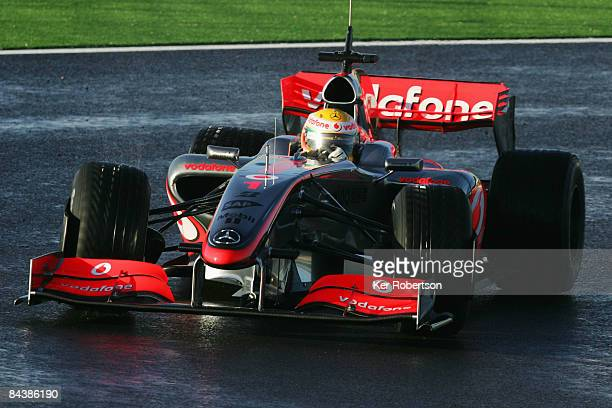Lewis Hamilton of Great Britain and McLaren Mercedes test drives the new McLaren MP424 during Formula One winter testing at the Autodromo...