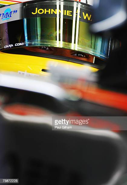 Lewis Hamilton of Great Britain and McLaren Mercedes waits in the garage before driving during practice for the Bahrain Formula One Grand Prix at the...