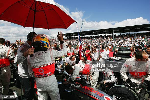 Lewis Hamilton of Great Britain and McLaren Mercedes waves to fans on the grid before the start of the British Formula One Grand Prix at Silverstone...