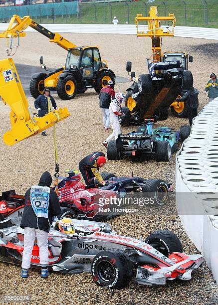 Lewis Hamilton of Great Britain and McLaren Mercedes,Mark Webber of Australia and Red Bull Racing and Jenson Button of Great Britain and Honda Racing...